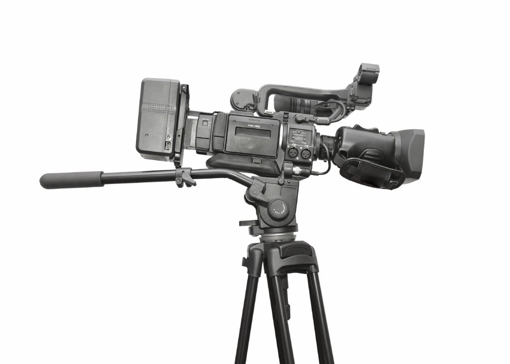 Professional video camera. White background