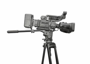 Professional video camera. White background