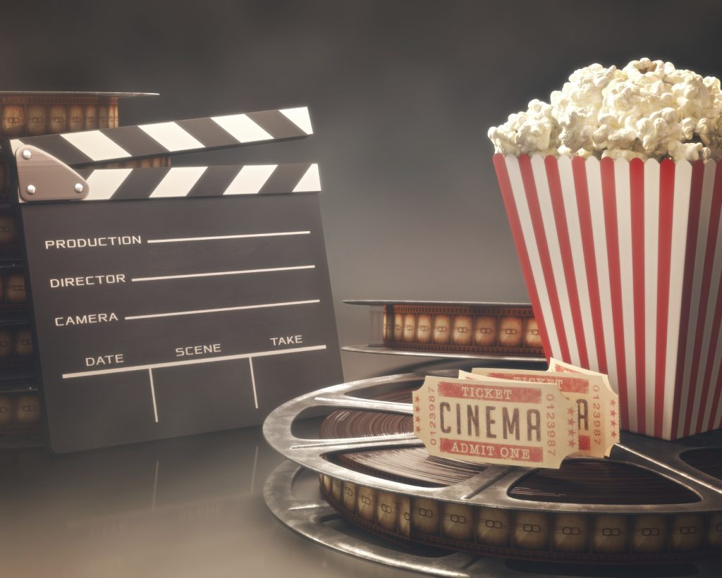 cine film, popcorn and admission tickets