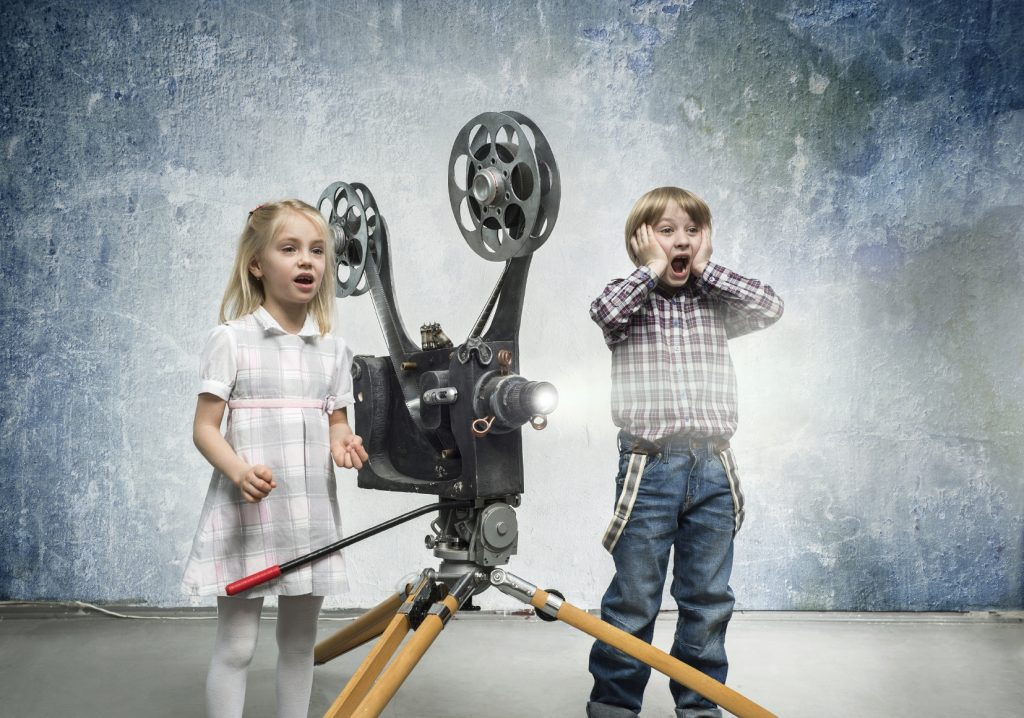 Children Being Amazed by a Cine Projector